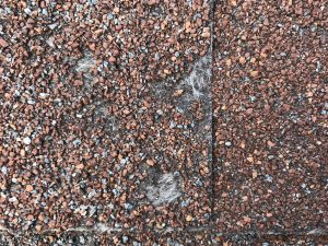 Roofing shingles with hail damage
